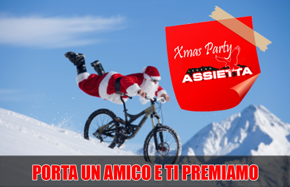 Santa Claus racing down snowy slope on bicycle